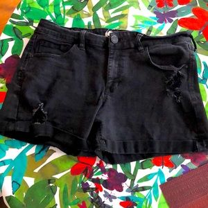 Stretchy, distressed black jean shorts